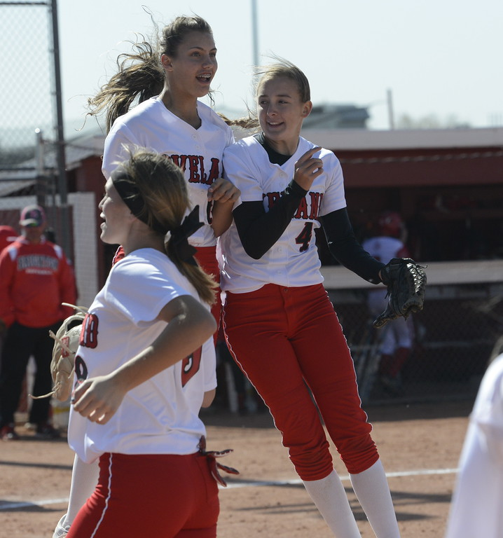 . Loveland\'s Laurin Krings, left, and Katie McClain bump shoulders on Saturday in Brighton.