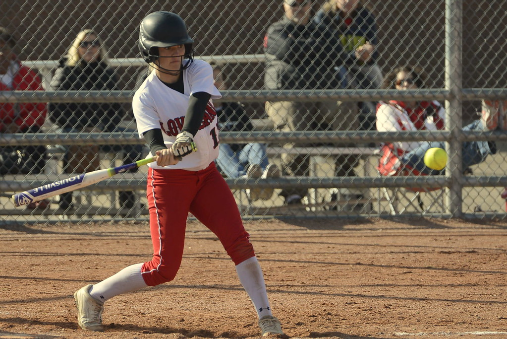 . Loveland senior Kassi Reiger takes a swing during the 5A Region 8 tournament on Saturday at Brighton High School.