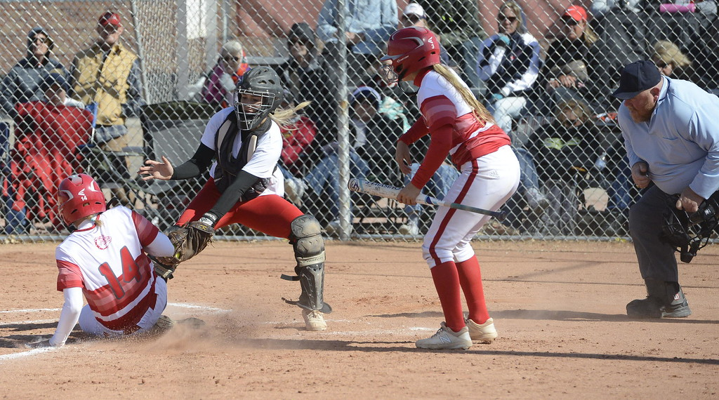 . Loveland senior catcher Kassi Reiger tags out Brighton\'s Kynzi Booth as she tries to steal home during the title game of the 5A Region 8 Tournament on Saturday at Brighton High School.