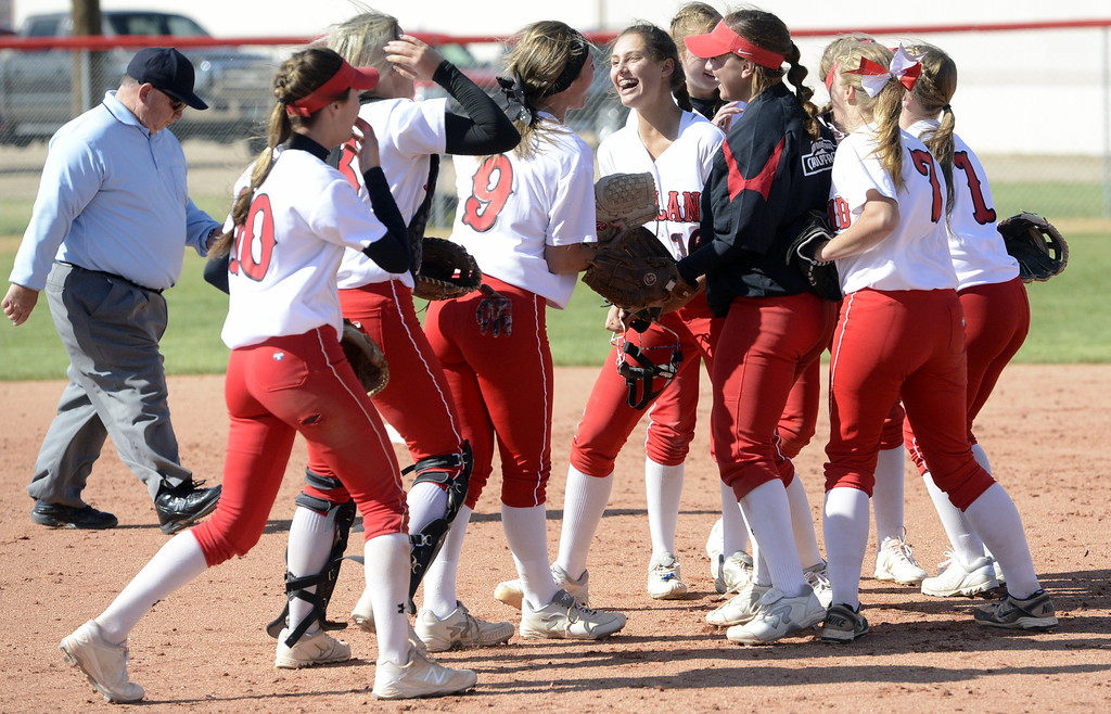 . Loveland softball players celebrate after beating Brighton 2-1 to win the 5A Region 8 Tournament on Saturday.