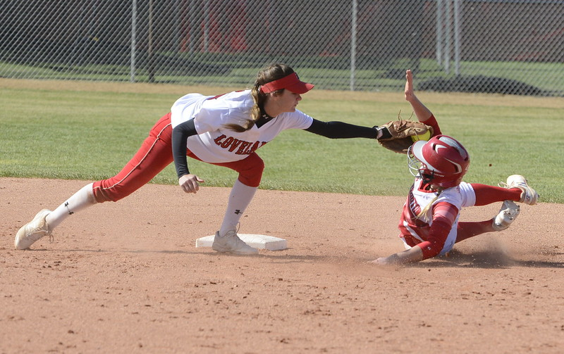 Loveland shortstop Jessi Case reaches to tag out an stolen base attempt by Brighton on Saturday.