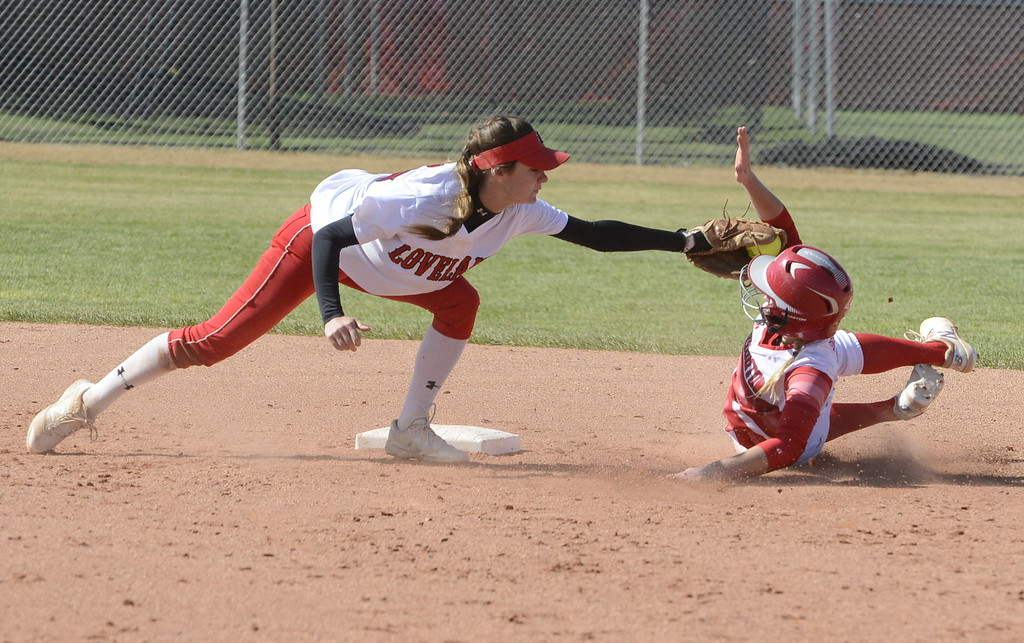. Loveland shortstop Jessi Case reaches to tag out an stolen base attempt by Brighton on Saturday.