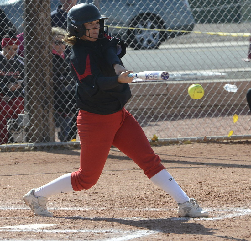 Loveland's Elana Gerhard makes contact at the plate on Saturday against Brighton.