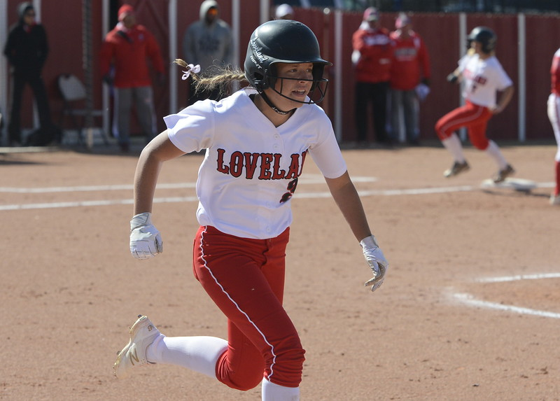 Loveland's Ryley Long runs up the first-base line on Saturday at Brighton.