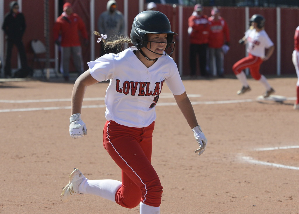 . Loveland\'s Ryley Long runs up the first-base line on Saturday at Brighton.