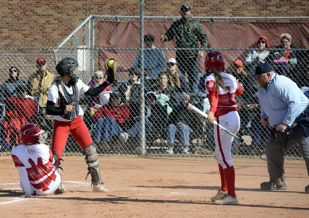 . Loveland catcher Kassi Reiger shows the umpire the ball after tagging out Brighton\'s Kynzi Booth on an attempted steal of home during the 5A Region 8 tournament on Saturday.