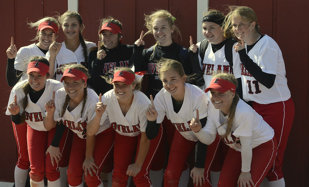 . The Loveland softball team poses for photos after winning the 5A Region 8 Tournament on Saturday at Brighton High School.