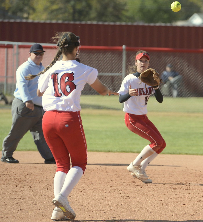 . Loveland pitcher Laurin Krings (16) throws to shortstop Jessi Case for a game-ending double play on Saturday at Brighton High School.
