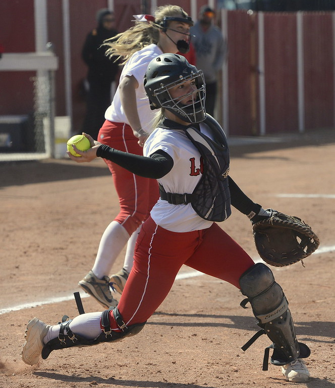. Loveland catcher Kassi Reiger throws to first during a regional title game against Brighton on Saturday.