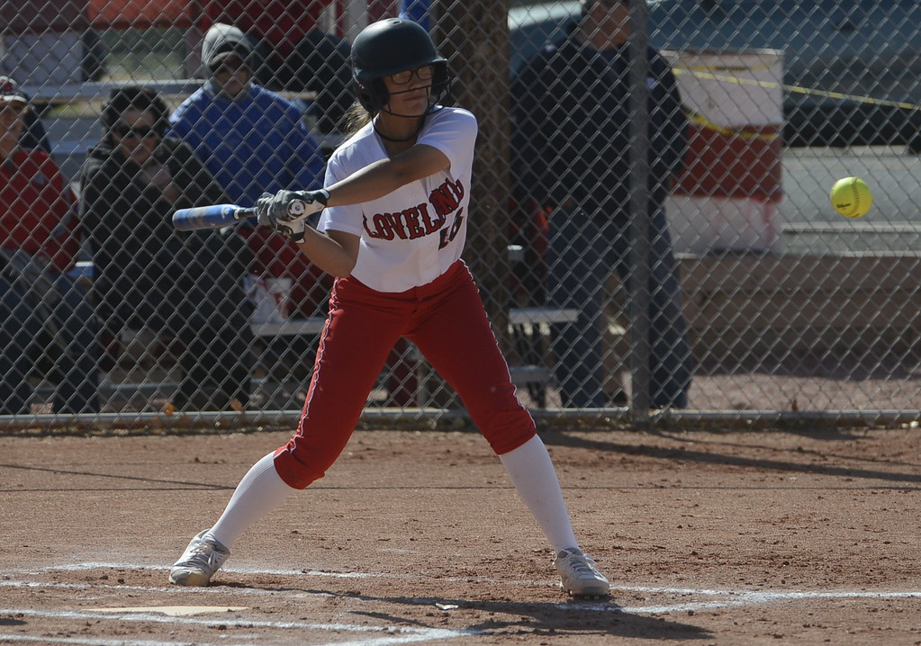 . Loveland\'s Laurin Krings is about to make contact on what was a solo home run on Saturday in Brighton.