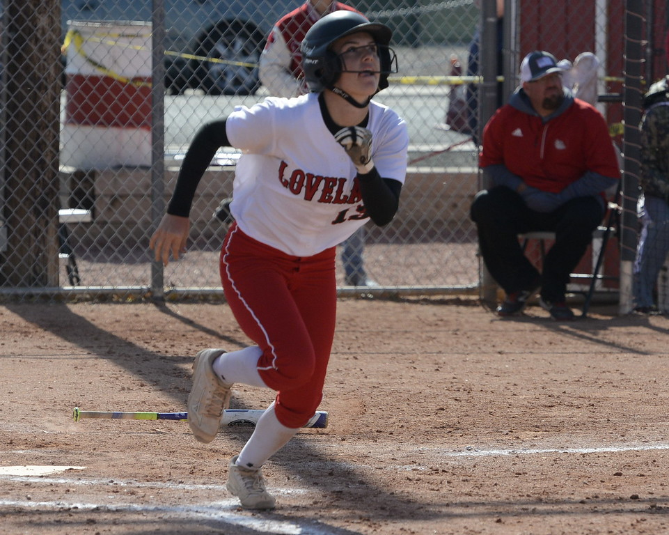Loveland senior Kassi Reiger watches her go-ahead RBI double during a regional title game at Brighton High School on Saturday.