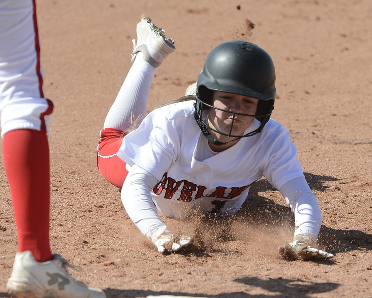 Loveland's Bri Mowry slides back to first base on Saturday at Brighton.