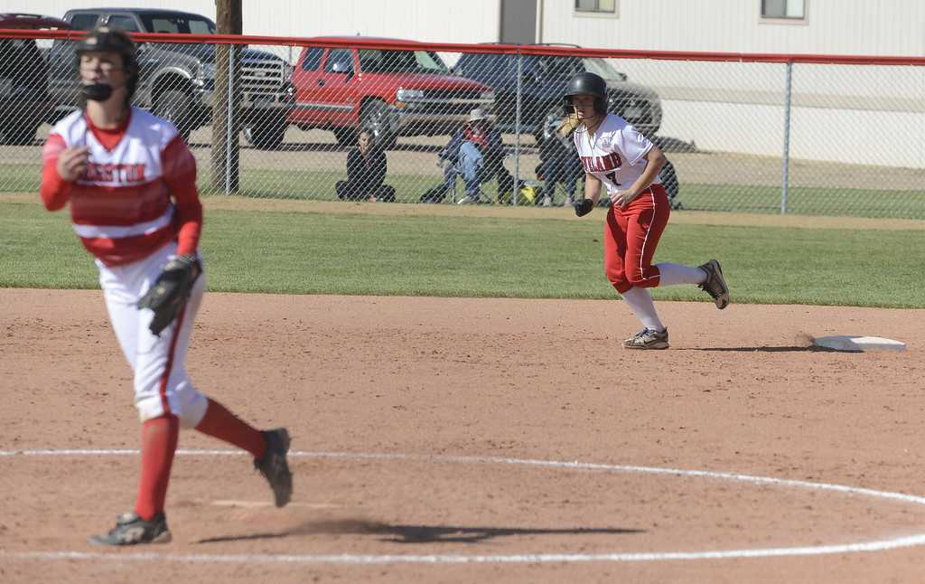 . Loveland\'s Emily Eggerling takes a lead from second base after a pitch by Brighton on Saturday.