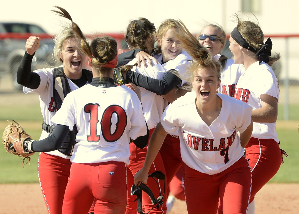 . Loveland softball players celebrate after defeating Brighton 2-1 to win the 5A Region 8 tournament on Saturday.