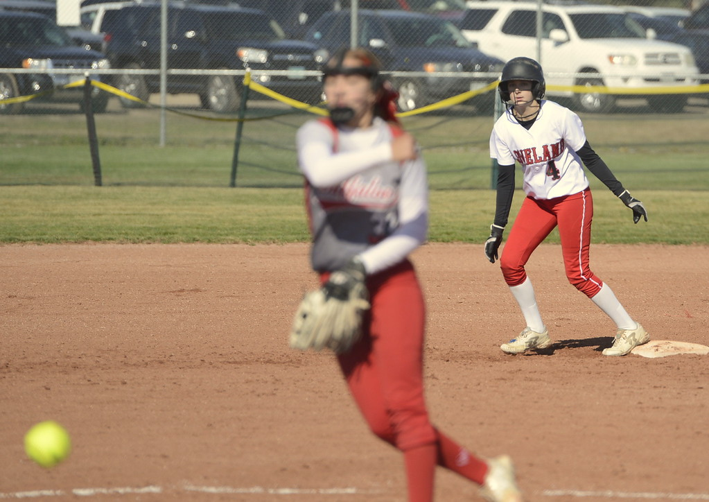 . Loveland junior Katie McClain watches a pitch against Smokey Hill during the 5A Region 8 tournament on Saturday at Brighton High School.