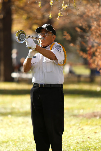 Honor Guard member Art Terrones plays taps during the ceremonial rifle volleys on Saturday, Nov. 11, 2017, at the Veterans Day ceremony at Dwayne Webster Veterans Park in Loveland. (Photo by Lauren Cordova/Loveland Reporter-Herald)
