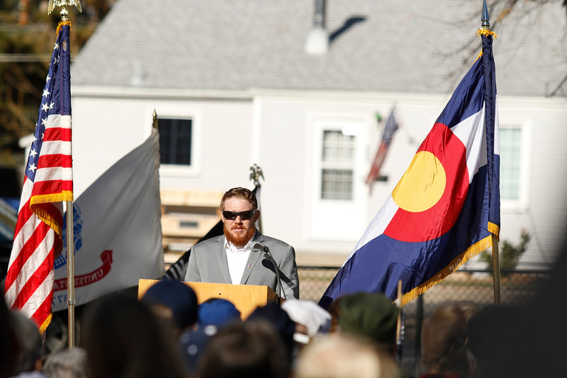 Marine Corps veteran and Purple Heart recipient  Joshua Kelly speaks about his experience serving on Saturday, Nov. 11, 2017, at the Veterans Day ceremony at Dwayne Webster Veterans Park in Loveland. (Photo by Lauren Cordova/Loveland Reporter-Herald)