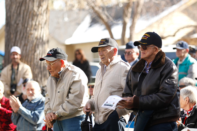 "World War II veterans Bill Powell, Charles ""Chuck"" Linhart and Phillip Daily stand to sing along with their service branch songs on Saturday, Nov. 11, 2017, at the Veterans Day ceremony at Dwayne Webster Veterans Park in Loveland. Powell and Daily were both taken as prisoners of war. Lindhart served in the 30th Infantry Division and was wounded in Italy. (Photo by Lauren Cordova/Loveland Reporter-Herald)"