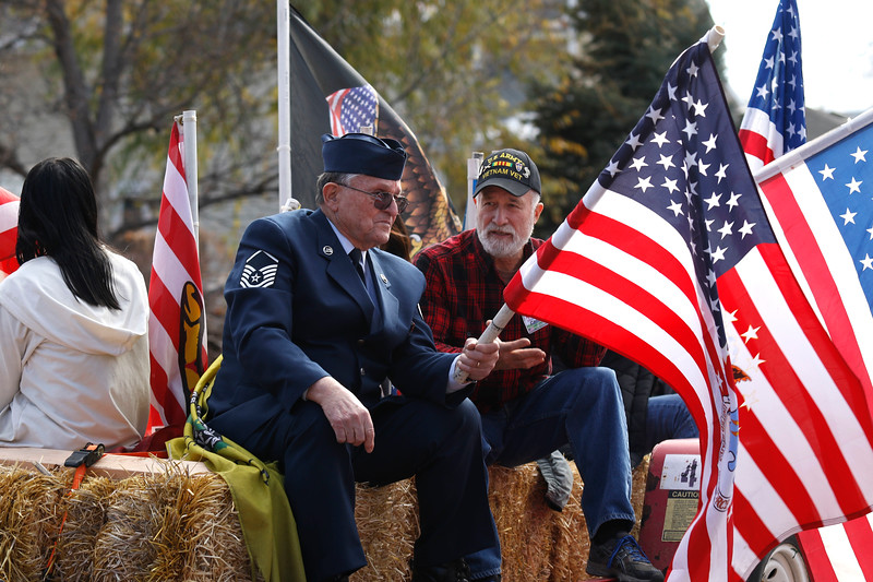 Veterans Don Fenske and Carl Ulm chat on their parade float on Saturday, Nov. 11, 2017, in Loveland.  Fenske served in the Air Force for 20 years and Ulm served in the Army for 24 years. (Photo by Lauren Cordova/Loveland Reporter-Herald)