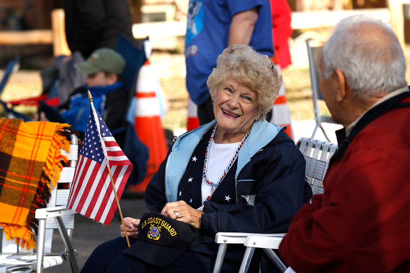 Phyllis Zimmerman looks on in excitement during the flyover, marking the start of the parade, on Saturday, Nov. 11, 2017, in Loveland. Zimmerman's husband Ronald of 50 years served in the Coast Guard in California and Oregon before settling in Loveland. (Photo by Lauren Cordova/Loveland Reporter-Herald)