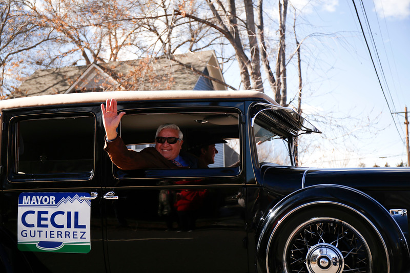 Loveland's Mayor Cecil Gutierrez waves from his car along Garfield Avenue during the Veterns Day parade on Saturday, Nov. 11, 2017, in Loveland. (Photo by Lauren Cordova/Loveland Reporter-Herald)