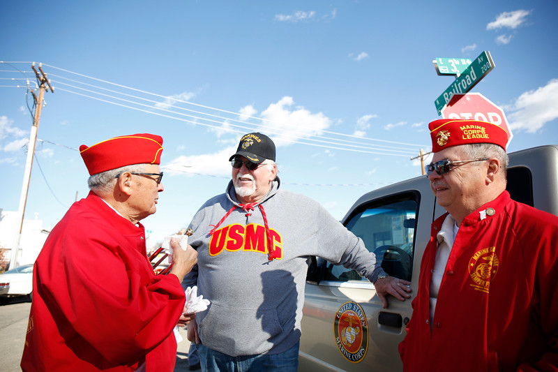 Veterans Gil Garcia, Greg Walent and Alan Woodhams chat in the staging are before the Veterans Day parade on Saturday, Nov. 11, 2017, in Loveland. All three men are part of the Marine Corps Leauge detatchment 1250. (Photo by Lauren Cordova/Loveland Reporter-Herald)