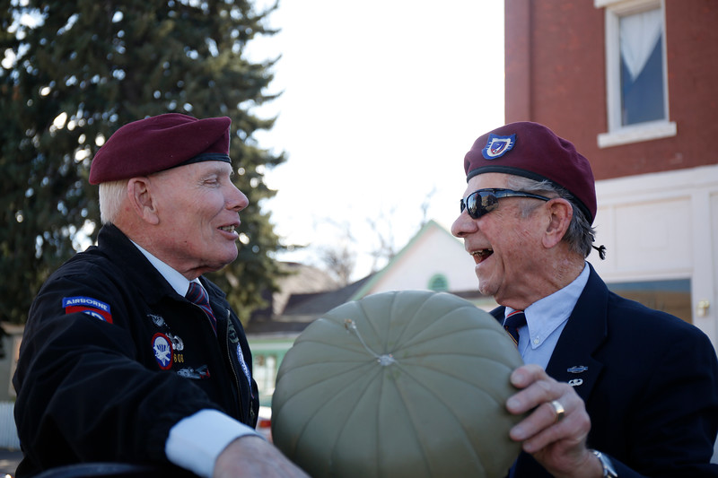 Veterns Bob Barnet and Jack Phillips laugh while trying to detanlge paratrooper figures to attached to their float before the parade on Saturday, Nov. 11, 2017, in Loveland. Both men served in the 82nd Airborne Division. (Photo by Lauren Cordova/Loveland Reporter-Herald)