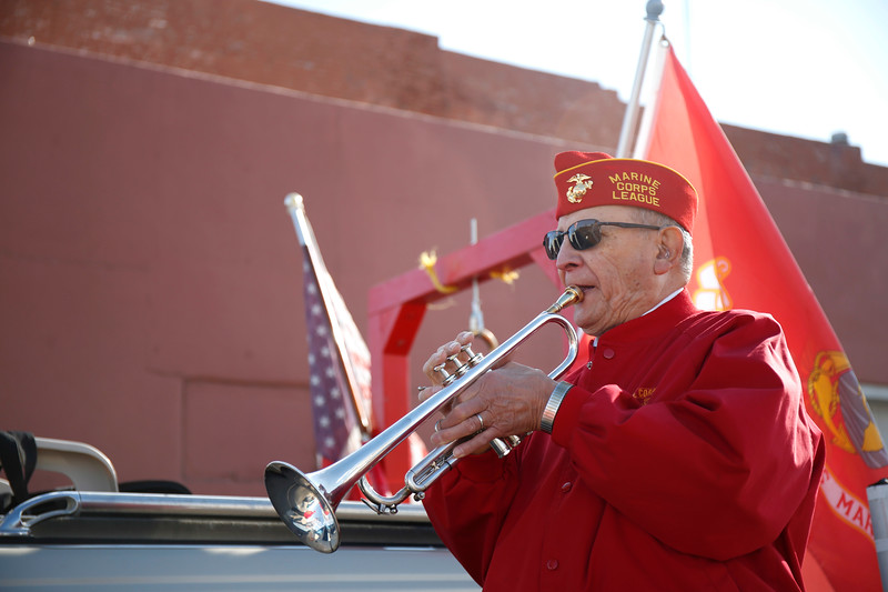 Marine Corps veteran Gil Garcia warms up on his trumpet before the Veterans Day parade begins on Saturday, Nov. 11, 2017, in Loveland. (Photo by Lauren Cordova/Loveland Reporter-Herald)