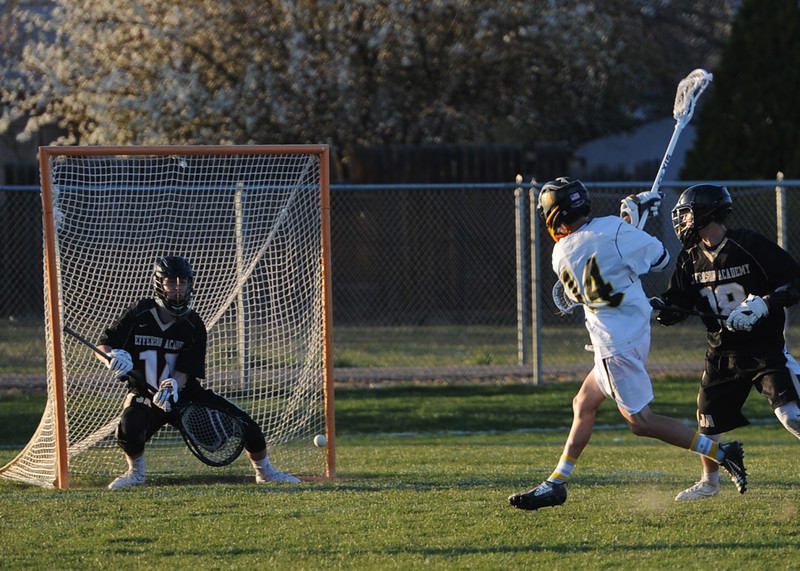 Thompson Valley's Jared McFerran (14) beats Jefferson Academy goalie Adam Reyes on Thursday at Patterson Stadium in Loveland. (Sean Star/Loveland Reporter-Herald)