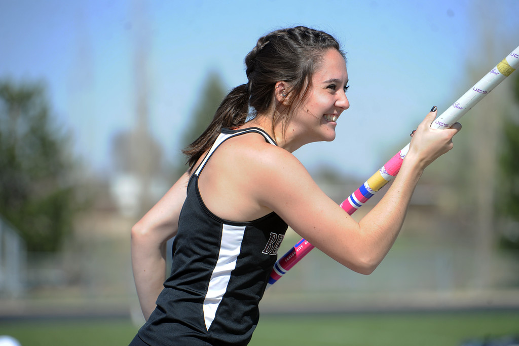 . Berthoud pole vaulter Emma Briles is all smiles during the Spartan Spike No. 2 Meet on Thursday at Berthoud High School. (Sean Star/Loveland Reporter-Herald)