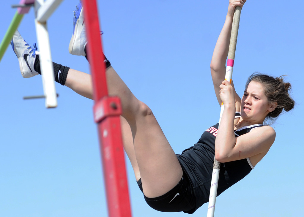 . Loveland\'s Morgan Madrid competes in the pole vault during the Spartan Spike No. 2 on Thursday at Berthoud High School. (Sean Star/Loveland Reporter-Herald)