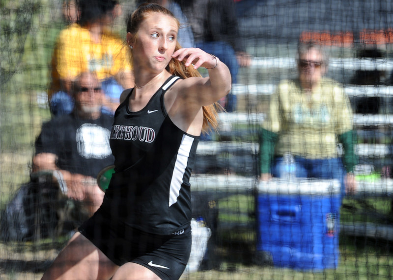 Berthoud's Emily Cavey throws the discus during the Spartan Spike No. 2 on Thursday at Berthoud High School. (Sean Star/Loveland Reporter-Herald)