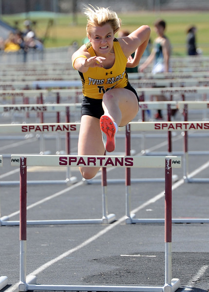 Thompson Valley's Lindsey Fancher-Owen runs the 100-meter hurdles during the Spartan Spike No. 2 Meet on Thursday at Berthoud High School. (Sean Star/Loveland Reporter-Herald)