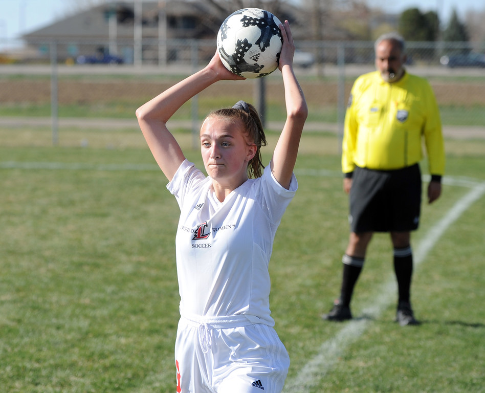 . Loveland\'s Josie Fugate goes for a throw-in during a game Thursday at Mountain View High School in Loveland. (Sean Star/Loveland Reporter-Herald)