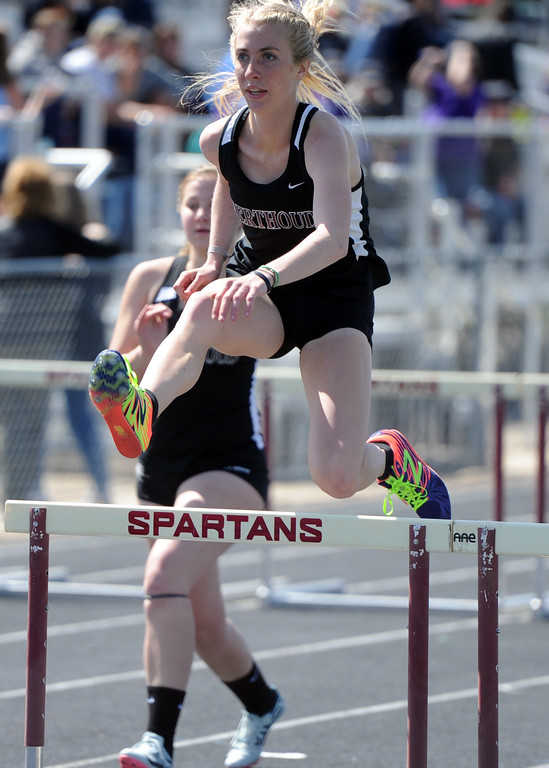 . Berthoud\'s Cailey Archer leaps toward the finish line during the 100-meter hurdles during the Spartan Spike No. 2 Meet on Thursday at Berthoud High School. (Sean Star/Loveland Reporter-Herald)