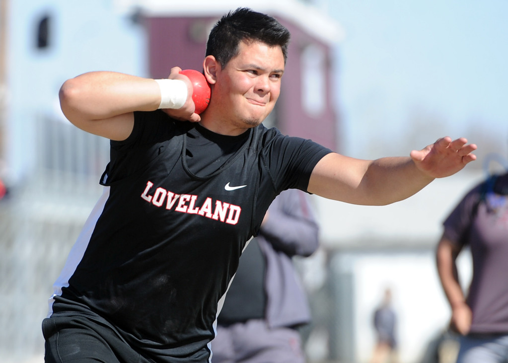 . Loveland\'s Jordyn Spencer tosses the shot put during the Spartan Spike No. 2 on Thursday at Berthoud High School. (Sean Star/Loveland Reporter-Herald)