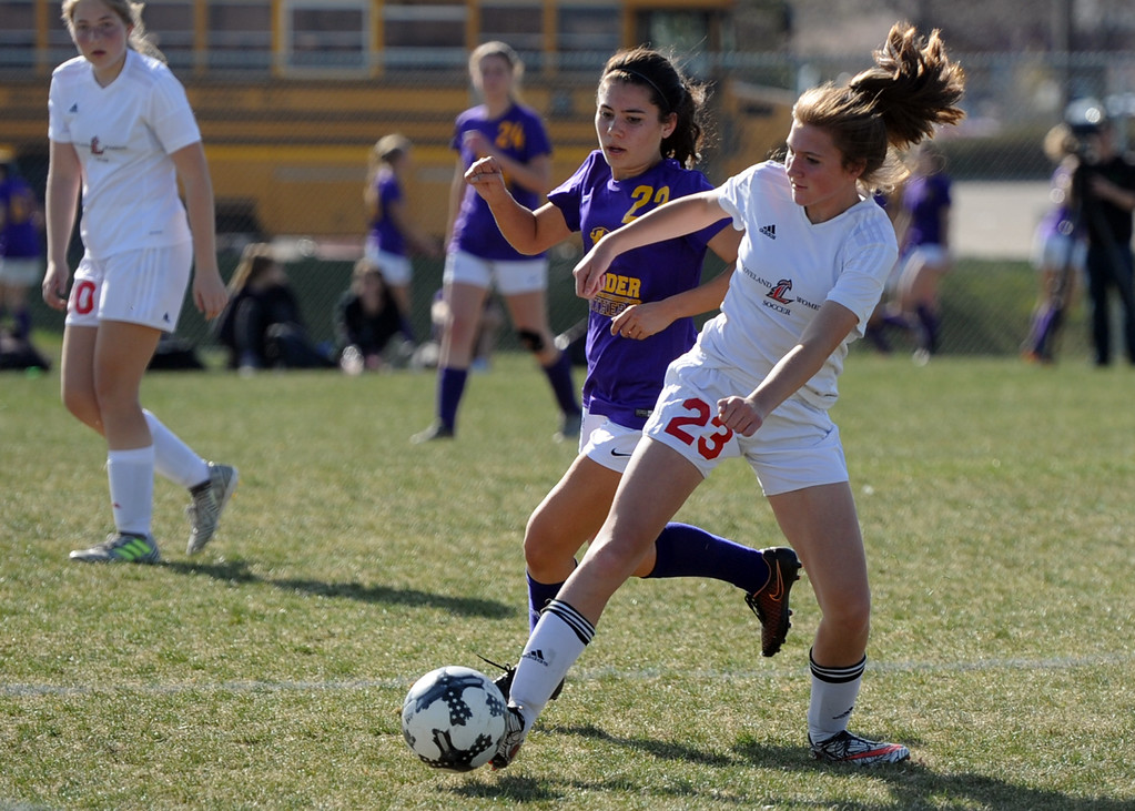 . Loveland\'s Carissa Morrison battles for possession with Boulder\'s Hannah Cairney on Thursday at Mountain View High School. (Sean Star/Loveland Reporter-Herald)