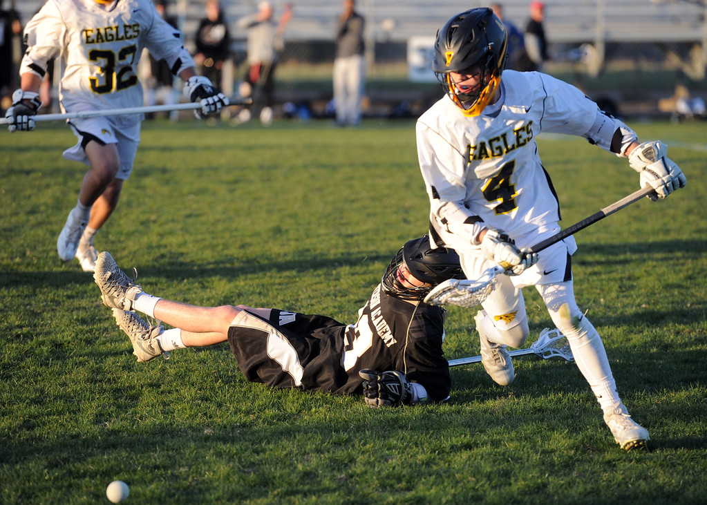 . Thompson Valley midfielder Jaydon Adfield (4) goes to scoop up a loose ball after colliding with Jefferson Academy\'s Joe Cesario on Thursday at Patterson Stadium. (Sean Star/Loveland Reporter-Herald)