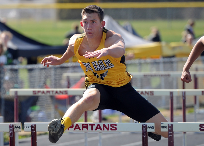 Thompson Valley's Nathan Rice runs the 110-meter hurdles during the Spartan Spike No. 2 Meet on Thursday at Berthoud High School. (Sean Star/Loveland Reporter-Herald)