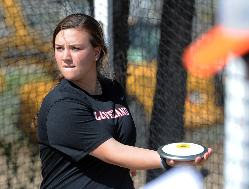. Loveland\'s Elana Gerhard gets ready to throw the discus during the Spartan Spike No. 2 on Thursday at Berthoud High School. (Sean Star/Loveland Reporter-Herald)