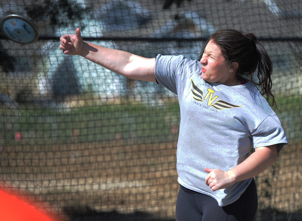 . Thompson Valley\'s JoAnne Ward throws the discus during the Spartan Spike No. 2 on Thursday at Berthoud High School. (Sean Star/Loveland Reporter-Herald)