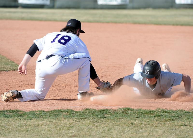 Mountain View first baseman Dakota Jimenez (18) applies a tag to Roosevelt baserunner Brandin Obrecht on Tuesday, April 3, 2018 at Brock Field in Loveland. (Sean Star/Loveland Reporter-Herald)