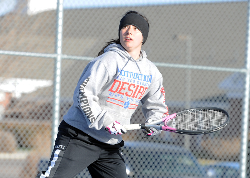 Mountain View's Kali Kelley keeps her eye on a return shot during a match Tuesday, April 3, 2018 at Mountain View High School. (Sean Star/Loveland Reporter-Herald)