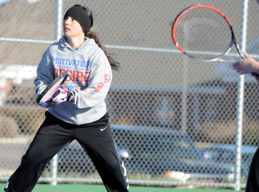 . Mountain View\'s Kali Kelley eyes a return during a match Tuesday, April 3, 2018 at Mountain View High School. (Sean Star/Loveland Reporter-Herald)