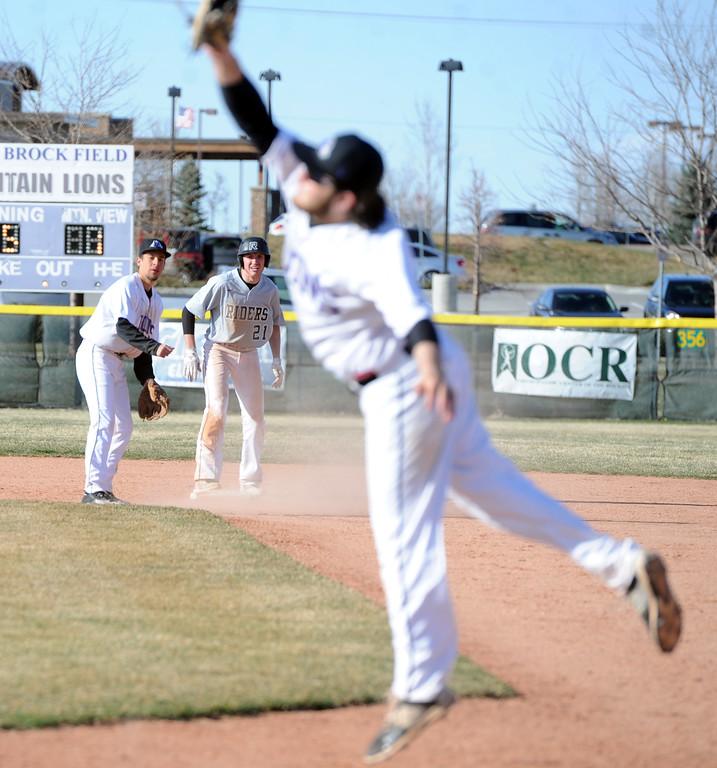 . Mountain View first baseman Dakota Jimenez leaps for a high throw from second baseman TJ Mendoza on Tuesday, April 3, 2018 at Brock Field in Loveland. (Sean Star/Loveland Reporter-Herald)