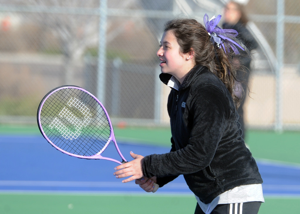 . Mountain View\'s Taylor Mills waits for a serve during a match Tuesday, April 3, 2018 at Mountain View High School. (Sean Star/Loveland Reporter-Herald)