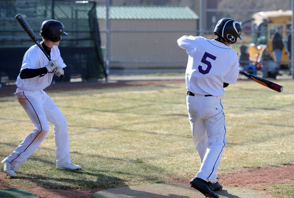 . Mountain View\'s Dylan Naughton, left, and Tanner Cartmell gets some practice cuts in on Tuesday, April 3, 2018 at Brock Field in Loveland. (Sean Star/Loveland Reporter-Herald)