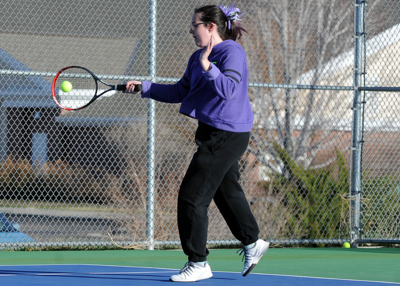 Mountain View's Dusty Berglund connects on a forehand during a match Tuesday, April 3, 2018 at Mountain View High School. (Sean Star/Loveland Reporter-Herald)