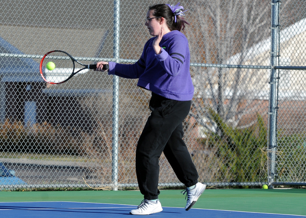 . Mountain View\'s Dusty Berglund connects on a forehand during a match Tuesday, April 3, 2018 at Mountain View High School. (Sean Star/Loveland Reporter-Herald)