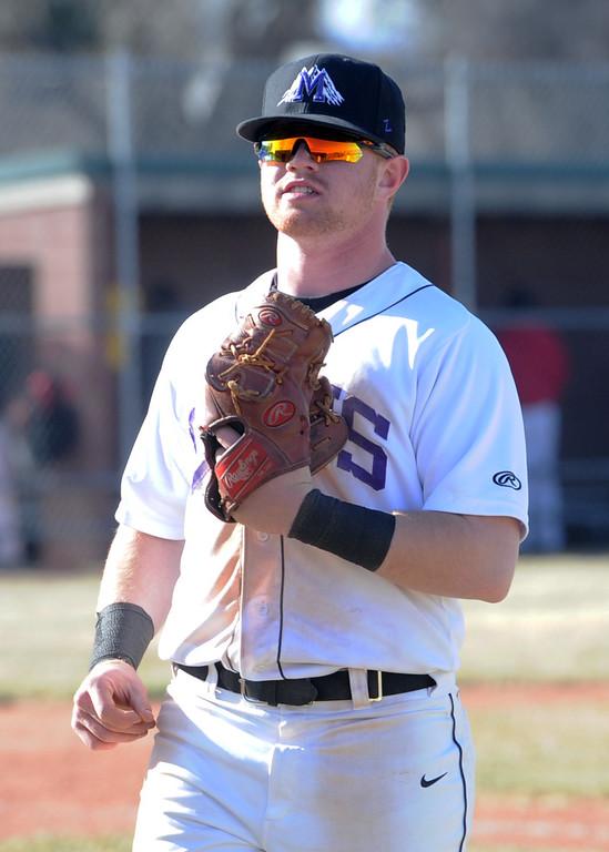 . Mountain View third baseman Braden Barker heads to the dugout on Tuesday, April 3, 2018 at Brock Field in Loveland. (Sean Star/Loveland Reporter-Herald)